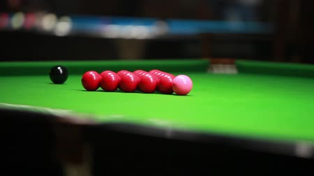 yarışma : Footage of a snooker table and a person breaking the balls... Stok Video