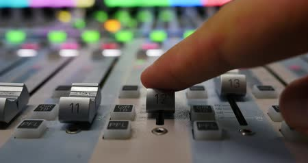 mikser : Close up shot of a man in a recording studio moving the knobs up... Stok Video
