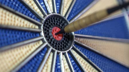 isabet : 4K close-up footage of a dart board and a person hitting the bullseye