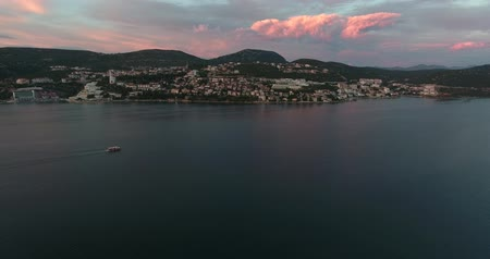 rivera : Aerial footage of the city Neum in Bosnia-Herzegovina, with a boat floating on the sea...