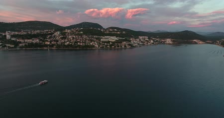 rivera : Aerial footage of the city Neum in Bosnia-Herzegovina, with a boat floating on the sea