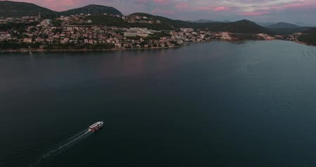 rivera : Aerial footage of the city of Neum in Bosnia-Herzegovina, with a boat floating on the sea...
