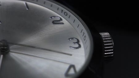 rozsdamentes acél : Close up footage of a seconds hand on a the clock, isolated on a black background...