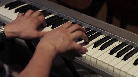 In a recording studio - a man playing on his piano... Wideo