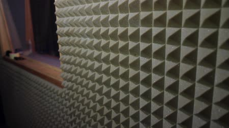 Footage of a soundproofed room in a recording studio...