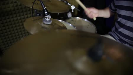 Footage of a person practicing drums in a recording studio... Wideo