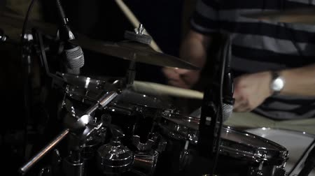 Footage of a drummer practicing drums in an isolated room... Wideo