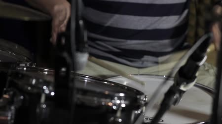 Footage of a man playing and practicing drums in a recording studio Wideo