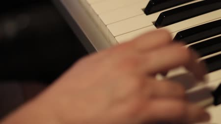 Footage of a man playing on his piano... Wideo