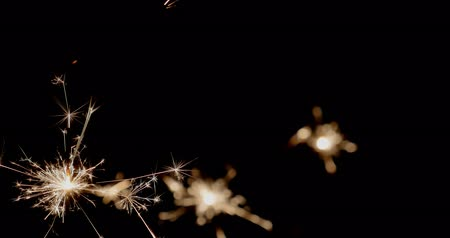 Footage of three sparklers burning in the dark... Wideo