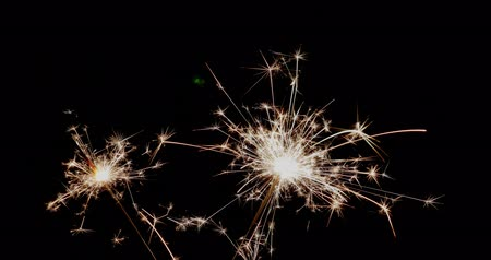 Footage of two sparklers burning in a dark night - with sound... Wideo