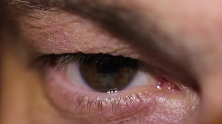 Time Lapse of a human eye reading something on a tablet, there is a reflection in his eye...
