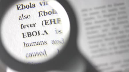 Footage of the ebola definition under the magnifier...