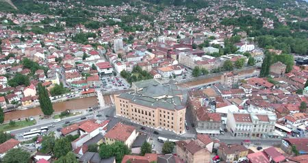 wwi : Aerial footage of Sarajevos national library and old town...