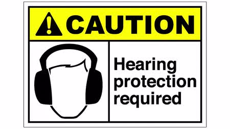 norms : A hearing protection required sign, the shot is coming into focus and goes again out of focus Stock Footage