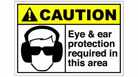 norms : An eye and ear protection required sign, the shot is coming into focus and goes again out of focus... Stock Footage