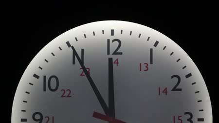 uhr : Clock in time lapse - it stops one minute before midnight.