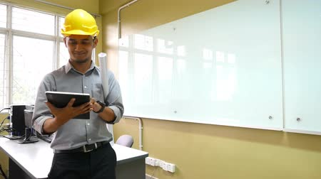 indian ethnicity : An architect using a tablet  with office environment.