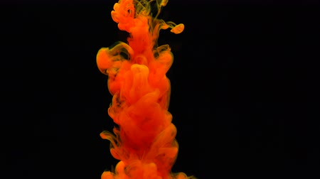 orange : Ink in water abstract background Stock Footage