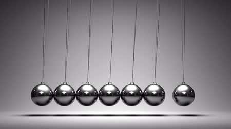 bezešvý : Balancing balls Newtons cradle on grey background. Seamless loop. Dostupné videozáznamy