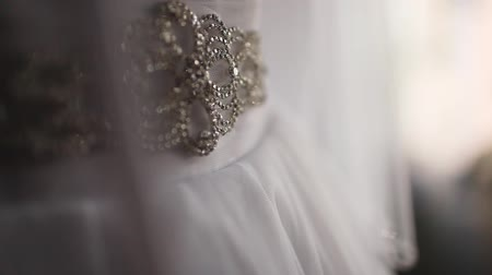 charges : white wedding dress richly shines