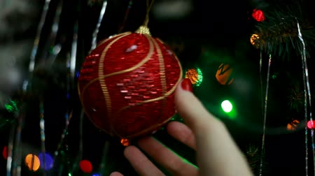 bombki : A big red ball hanging on a Christmas tree Wideo