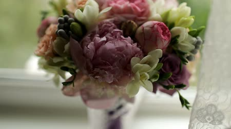 glass pitcher : Bouquet of pink peonies in white pitcher on a windowsill