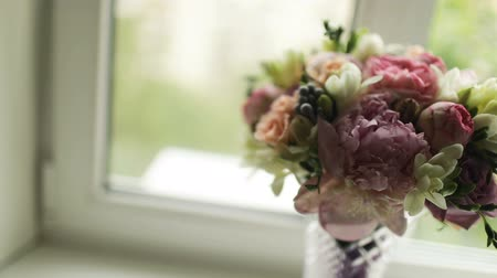 pitcher : Bouquet of pink peonies in white pitcher on a windowsill
