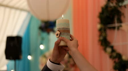 сибирский : Wedding day candle is a beautiful decoration in the restaurant