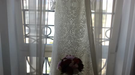 White wedding dress with lace hanger