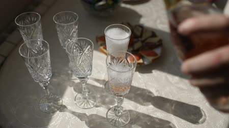 white wedding glasses with rhinestones are on the table