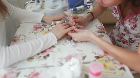 Manicure process in beauty