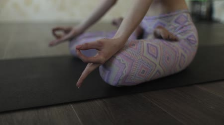 Young woman meditating in yoga class.
