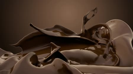chocolade : Gesmolten chocolade splash in slow motion