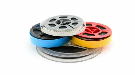 cassette : ilm reels rotating on white background Stock Footage