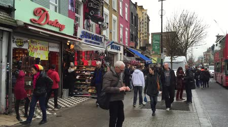 buckingham palace : LONDON - DECEMBER 6: people walking in Camden Town district of London punk on December 6.2015 in London -UK Stock Footage