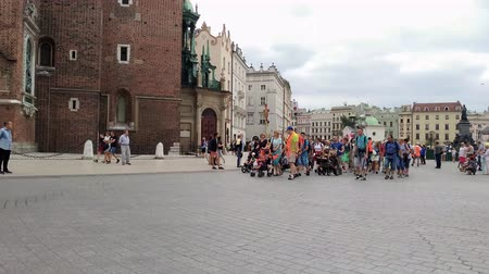 wisla : KRAKOW, POLAND - AUGUST 3, 2017:  people walking on the Market Square (Rynek Glowny) It is a largest square measuring 200 meters on the side, and is the largest medieval square in Europe.