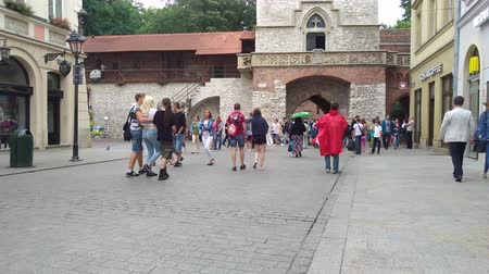 wisla : KRAKOW, POLAND - AUGUST 3, 2017:  people walking across the San Florian Gate. It is part of the town wall dating back to the 14th century and was the main access to the city.