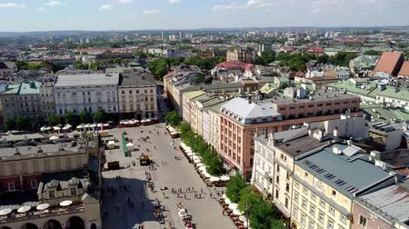 wisla : KRAKOW, POLAND - AUGUST 3, 2017: Top view of the Market Square (Rynek Glowny) It is the largest square measuring 200 meters on the side and is the largest medieval square in Europe. Stock Footage