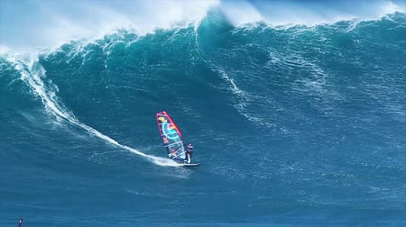 MAUI, HI - MARCH 13: Professional windsurfer Jason Polakow rides a giant wave at Jaws. March 13, 2011 in Maui, HI.