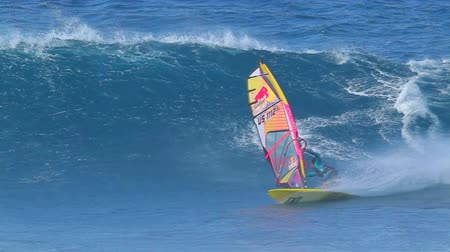 MAUI, HI - MARCH 13: Professional windsurfer Kai Lenny rides a large ocean wave. March 13, 2011 in Maui, HI. Wideo
