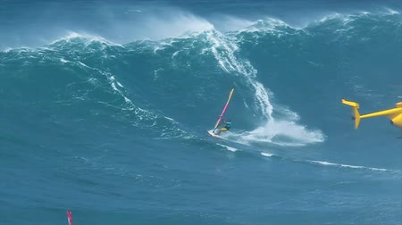 MAUI, HI - MARCH 13: Professional windsurfer Kai Lenny rides a giant wave at Jaws. March 13, 2011 in Maui, HI. Wideo