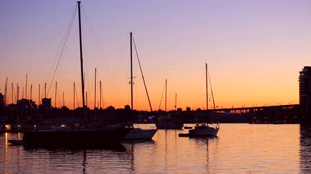 sunset sea : Beautiful sunset over ocean, Boats and City Stock Footage