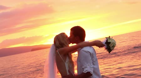 sunset sea : Just married couple on beach at sunset