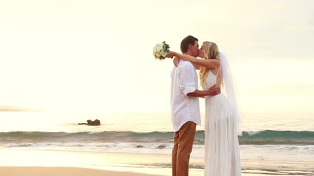 buket : Just married couple on beach at sunset