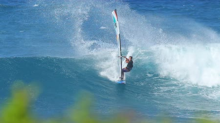sportowiec : MAUI, HI - February 1: Professional windsurfer Levi Siver rides a wave at Hookipa Beach. Strong wind and large waves made for extreme windsurfing and big airs. February 1, 2012 in Maui, HI.