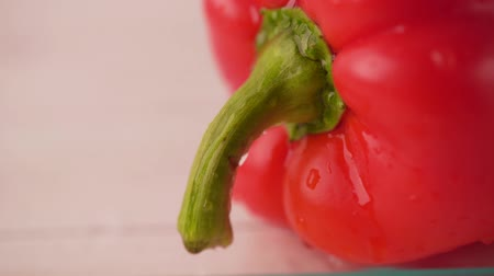 peppercorn : Fresh organic red pepper on a white background, close-up, shallow depth of field. Bulgarian pepper. Fresh delicious salad ingredient. The concept of healthy eating.