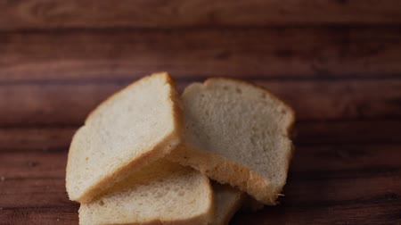 crust : Slices of bread on wooden background