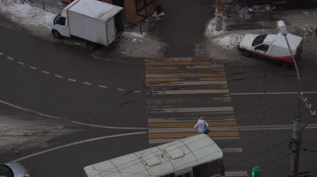 zebra : Pedestrians Crosswalk, High Angle View. Pedestrian crossing a street with vehicles in Russia. High angle view Stock Footage