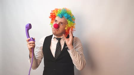 hamis : Office worker in clown wig, clown concept at work. Businessman with clown wig isolated on white
